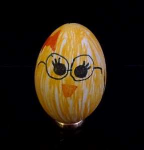 Every Easter my family decorates blown eggs. My daughter made this one for me. Look familiar?