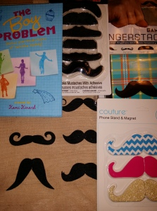 Signed copy of The Boy Problem, hairy mustaches, fingerstaches, mustache cell phone holders/magnets, mustache journal, and super-cute burlap mustache tote bag!